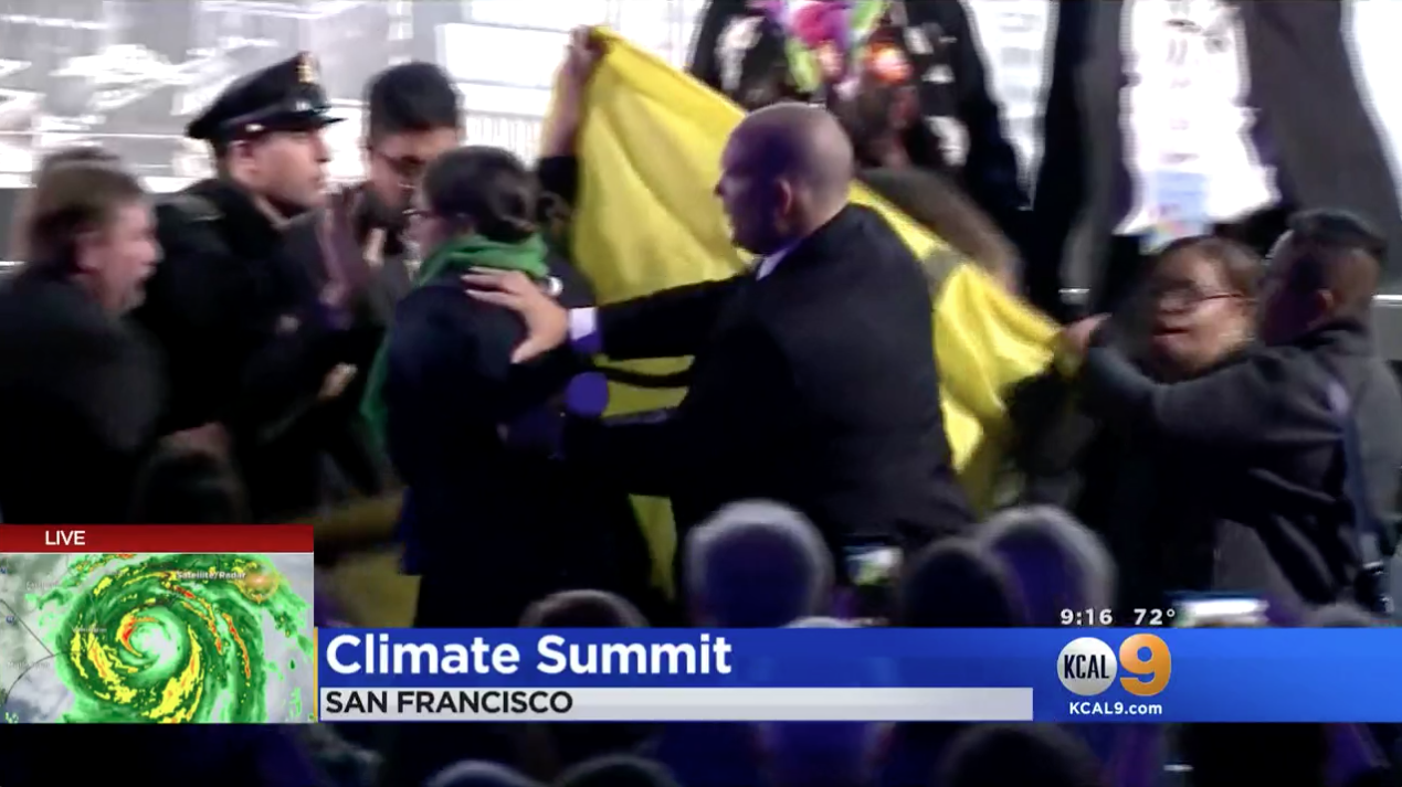Protestors disrupt climate summit