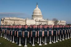 "Mark Zuckerberg cut-outs with shirts that say ""Fix Fakebook"" in front of Capitol Hill"
